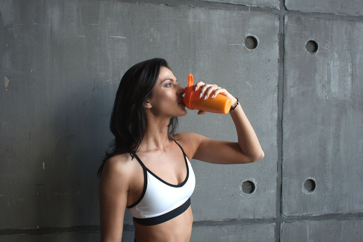 Girl taking a creatine supplement