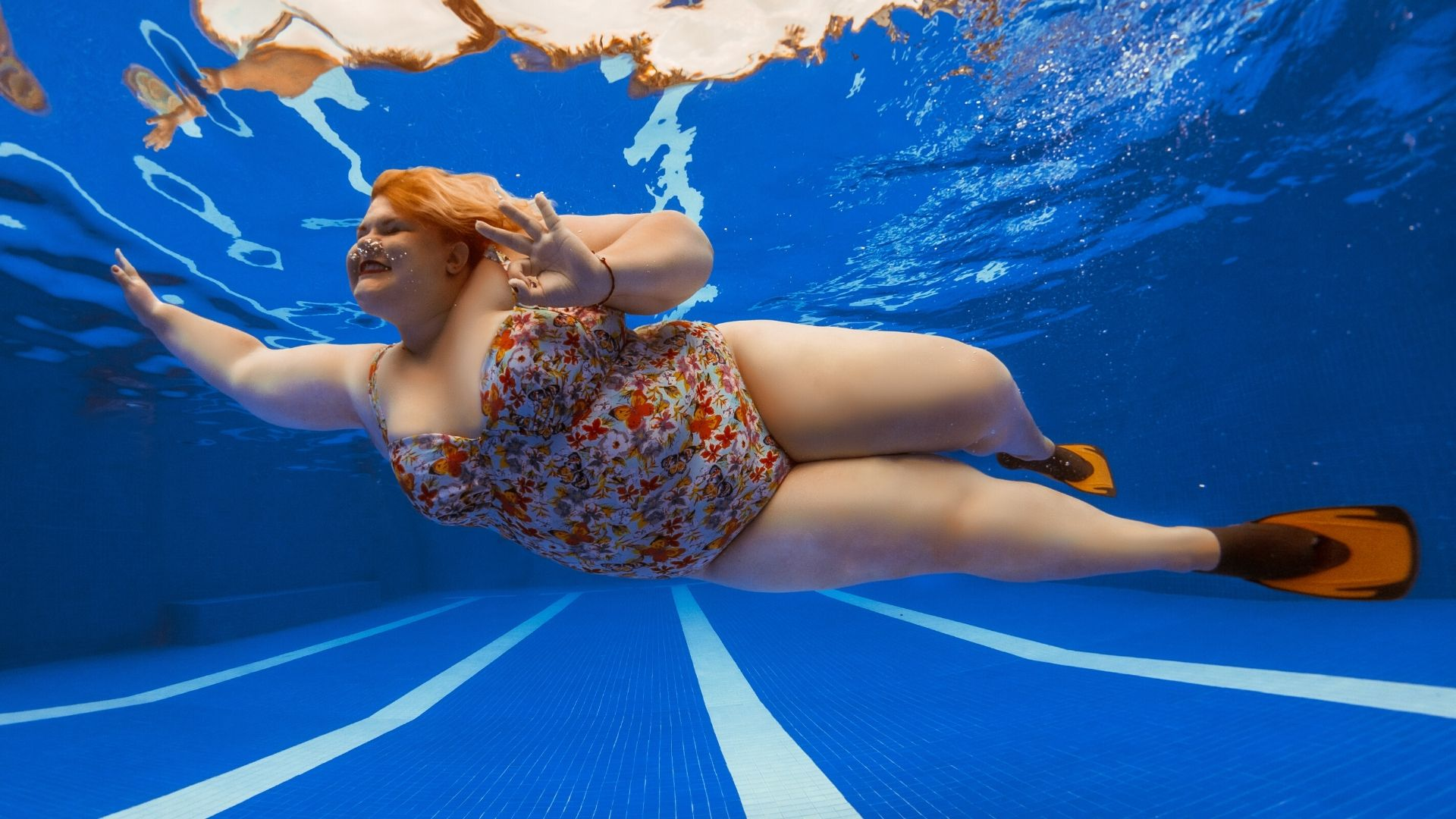 Obese woman swimming
